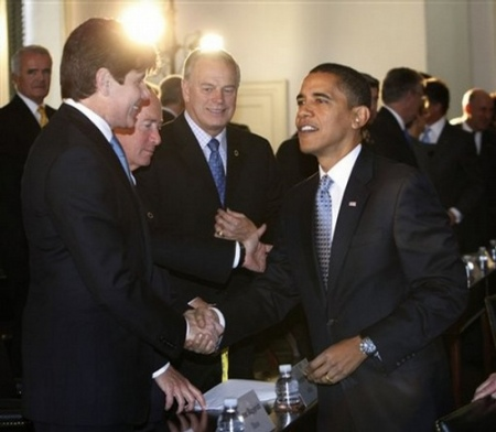 President-elect Barack Obama, right, greets Illinois Gov. Rob Blagojevich, left, at the Bipartisan meeting of the National Governor's Association at Congress Hall, Tuesday, Dec. 2, 2008 in Philadelphia, Pa.
